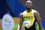 FILE - In this Aug. 18, 2016, file photo, Jamaica's Asafa Powell smiles after the men's 4x100-meter relay at the 2016 Summer Olympics in Rio de Janeiro, Brazil. There's no retirement talk even with the Tokyo Games delayed for a year due to the coronavirus. Justin Gatlin will be 39 by the time the games roll around, and Powell is just nine months younger. They are both ancient in this young sprinter's game. (AP Photo/Matt Dunham, File)