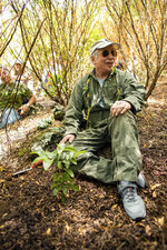 In this Friday, Aug. 16, 2019 photo, musician Paul Simon sits after planting a lama tree at Auwahi Forest Reserve on Maui, Hawaii as a part of a growing forest restoration effort on Hawaii's second largest island. (Anna Kim/Honolulu Star-Advertiser via AP)