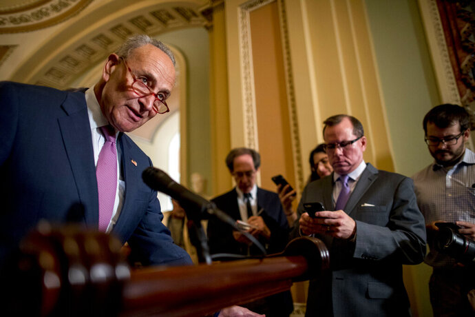 Senate Minority Leader Sen. Chuck Schumer of N.Y., left, speaks at a news conference following a Senate policy luncheon on Capitol Hill, Tuesday, Sept. 10, 2019, in Washington. (AP Photo/Andrew Harnik)