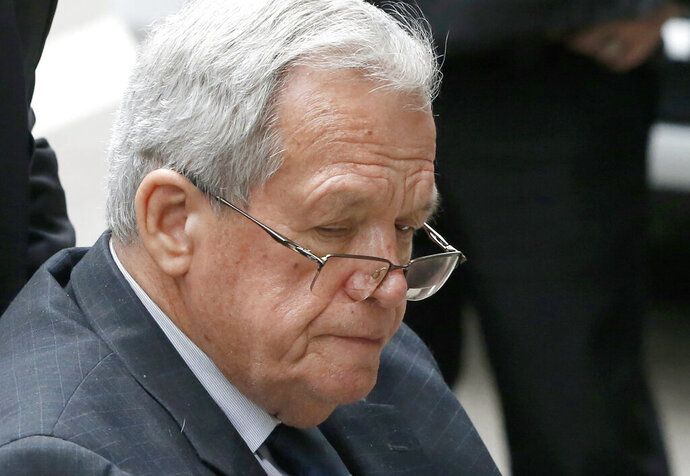 FILE - In this April 27, 2016, file photo, former House Speaker Dennis Hastert leaves the federal courthouse in Chicago. An Illinois judge has determined a former student who was sexually abused by Hastert breached an unwritten $3.5 million hush-money deal with the former U.S. House Speaker by telling family members and a friend about it. (AP Photo/Charles Rex Arbogast, File)