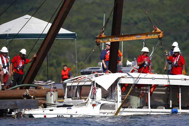FILE - In this July 23, 2018 file photo, a duck boat that sank in Table Rock Lake in Branson, Mo., is raised after it went down the evening of July 19 after a thunderstorm generated near-hurricane strength winds, killing 17 people. The owner of the tourist duck boat has settled its final pending lawsuit for an undisclosed amount. (Nathan Papes/The Springfield News-Leader via AP, File)