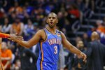 Oklahoma City Thunder guard Chris Paul shouts after making a basket against the Phoenix Suns during the second half of an NBA basketball game Friday, Jan. 31, 2020, in Phoenix. The Thunder won 111-107. (AP Photo/Ross D. Franklin)