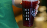 FILE - In this March 18, 2015, file photo, a Starbucks barista holds an iced tea drink with a