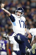 Tennessee Titans quarterback Ryan Tannehill (17) celebrates his touchdown against the Baltimore Ravens during the second half of an NFL divisional playoff football game, Saturday, Jan. 11, 2020, in Baltimore. (AP Photo/Julio Cortez)