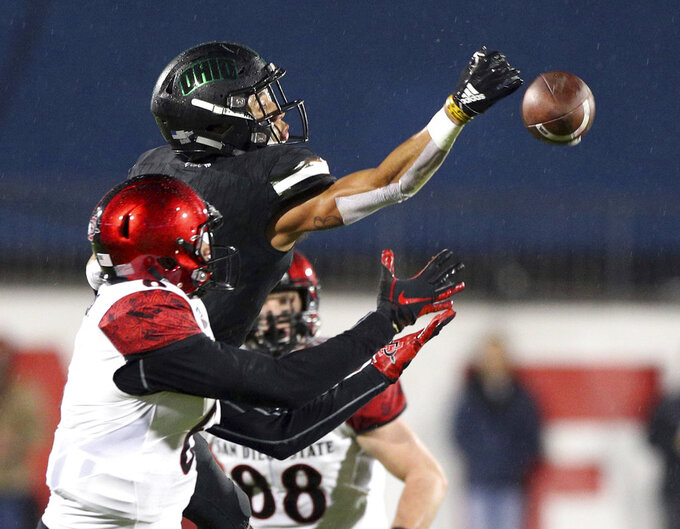 Ohio cornerback Marlin Brooks (22) breaks up a pass intended for San Diego State wide receiver Tim Wilson Jr. (6) in the first half of the Frisco Bowl NCAA college football game, Wednesday, Dec. 19, 2018, in Frisco, Texas. (AP Photo/Richard W. Rodriguez)