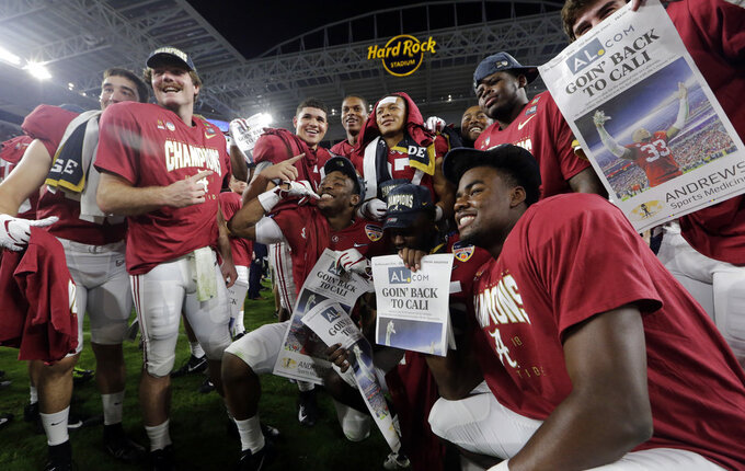 The Alabama team poses on the field at the end of the Orange Bowl NCAA college football game against Oklahoma, Saturday, Dec. 29, 2018, in Miami Gardens, Fla. Alabama defeated Oklahoma 45-34. (AP Photo/Lynne Sladky)