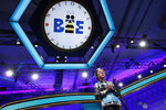 FILE - In this May 31, 2018 file photo, Lauren Guo, 12, from Arvada, Colo., competes in the Scripps National Spelling Bee in Oxon Hill, Md.  An unremarkable sound can be the toughest thing for spellers to master at the Scripps National Spelling Bee. It's known as the schwa. It sounds like