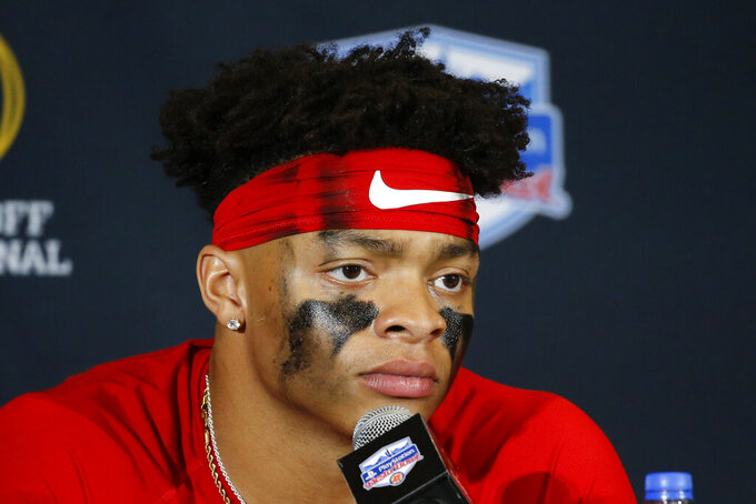 Ohio State quarterback Justin Fields speaks during a news conference after the team's 29-23 loss to Clemson in the Fiesta Bowl NCAA college football playoff semifinal Saturday, Dec. 28, 2019, in Glendale, Ariz. (AP Photo/Ross D. Franklin)