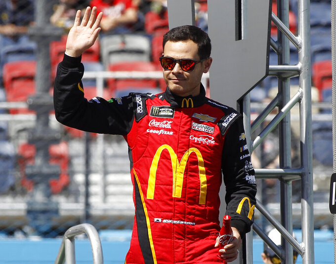 Kyle Larson waves to the crowd during driver introductions prior to the start of the NASCAR Cup Series auto race at ISM Raceway, Sunday, March 10, 2019, in Avondale, Ariz. (AP Photo/Ralph Freso)