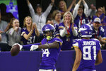 Minnesota Vikings wide receiver Stefon Diggs (14) celebrates with teammate Bisi Johnson, right, after catching a 54-yard touchdown pass during the second half of an NFL football game against the Denver Broncos, Sunday, Nov. 17, 2019, in Minneapolis. (AP Photo/Jim Mone)