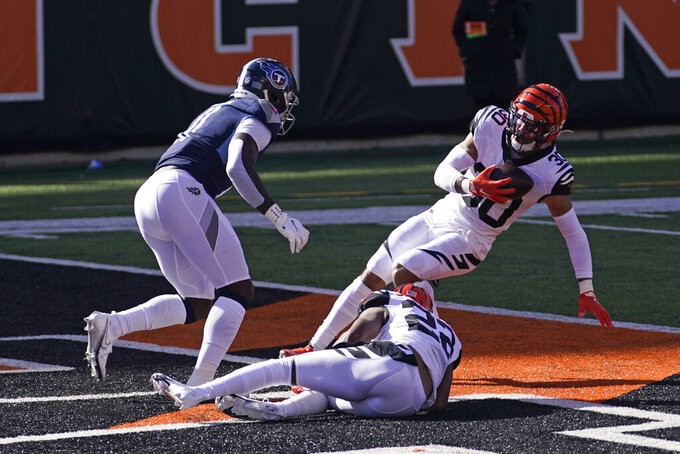 Cincinnati Bengals' Jessie Bates (30) intercepts a pass intended by Tennessee Titans' A.J. Brown during the first half of an NFL football game, Sunday, Nov. 1, 2020, in Cincinnati. (AP Photo/Bryan Woolston)