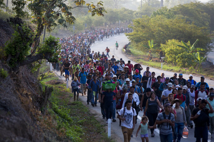 Central American migrants, part of a caravan hoping to reach the U.S. border, move on the road in Escuintla, Chiapas State, Mexico, Saturday, April 20, 2019. Thousands of migrants in several different caravans have been gathering in Chiapas in recent days and weeks. (AP Photo/Moises Castillo)