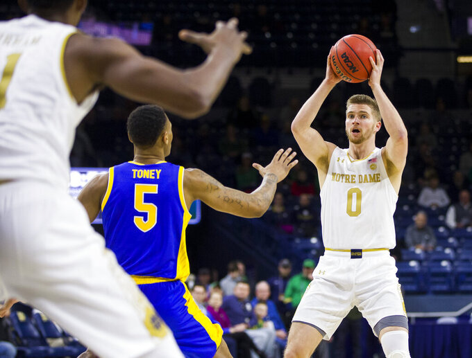 Notre Dame's Rex Pflueger (0) looks to pass around Pittsburgh's Au'diese Toney (5) during the first half of an NCAA college basketball game Wednesday, Feb. 5, 2020, in South Bend, Ind. (AP Photo/Robert Franklin)