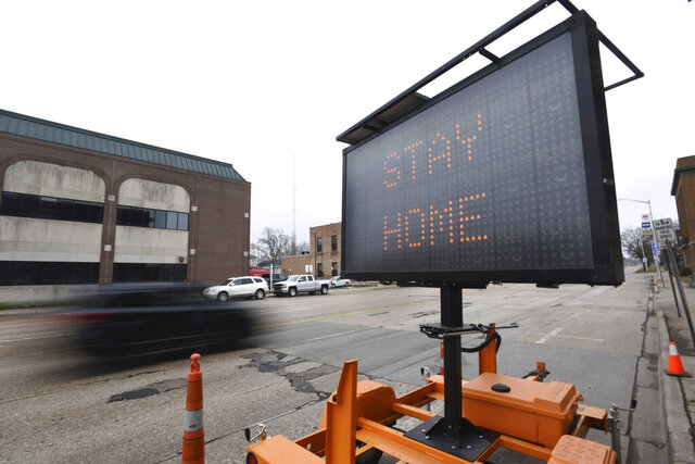A sign encourages the public to stay at home and stay safe during the coronavirus outbreak Friday, March 27, 2020, in downtown St. Joseph, Mich. Officials declared a state of emergency for Berrien County on Thursday due to the COVID-19 pandemic.(Don Campbell/The Herald-Palladium via AP)