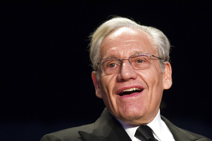 FILE - In this April 29, 2017, file photo journalist Bob Woodward sits at the head table during the White House Correspondents' Dinner in Washington. Woodward, facing widespread criticism for only now revealing President Donald Trump's early concerns about the severity of the coronavirus, told The Associated Press that he needed time to be sure that Trump's private comments from February were accurate. (AP Photo/Cliff Owen, File)