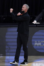 Southern California head coach Andy Enfield directs his team during the first half of an Elite 8 game against Gonzaga in the NCAA men's college basketball tournament at Lucas Oil Stadium, Tuesday, March 30, 2021, in Indianapolis. (AP Photo/Darron Cummings)