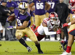 Washington running back Myles Gaskin (9) runs in front of Utah defensive back Corrion Ballard during the first half of the Pac-12 Conference championship NCAA college football game in Santa Clara, Calif., Friday, Nov. 30, 2018. (AP Photo/Tony Avelar)