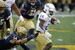Tulsa running back Corey Taylor II (24) runs with the ball past Navy linebacker Diego Fagot (54) during the first half of an NCAA college football game, Saturday, Dec. 5, 2020, in Annapolis, Md. (AP Photo/Nick Wass)