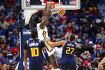 New Orleans Pelicans forward Zion Williamson (1) dunks over Utah Jazz center Rudy Gobert (27) during the second half of a preseason NBA basketball game in New Orleans, Friday, Oct. 11, 2019. (AP Photo/Tyler Kaufman)