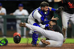 Baltimore Orioles' Jonathan Villar, right, beats the tag by Kansas City Royals catcher Nick Dini, left, during the seventh inning of a baseball game at Kauffman Stadium in Kansas City, Mo., Friday, Aug. 30, 2019. Villar stole home plate on the play. (AP Photo/Orlin Wagner)