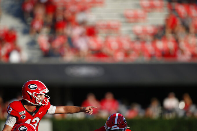 Georgia quarterback Stetson Bennett (13) calls out before running a play in the second half of an NCAA football game between Georgia and Murray State in Athens, Ga., on Saturday, Sept. 7, 2019. Georgia won 63-17. (Joshua L. Jones/Athens Banner-Herald via AP)