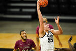 Iowa center Luka Garza drives to the basket during the first half of an NCAA college basketball game against North Carolina Central, Wednesday, Nov. 25, 2020, in Iowa City, Iowa. (AP Photo/Charlie Neibergall)