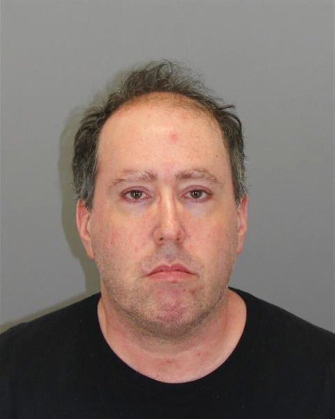 This photo provided by Wayne County Airport Authority Police Department in Romulus, Mich., shows H. Michael Borovetz.  Authorities say Borovetz, who has a history of scamming people at airports around the country is now accused of trying to get money from travelers in Michigan. Officers arrested Borovetz on Saturday, Aug. 10, 2019 at Detroit Metropolitan Airport in Romulus after getting a tip he'd have a flight layover at the airport. Airport officials say they'd been on the lookout for him since 2015.  (Wayne County Airport Authority Police Department via AP)
