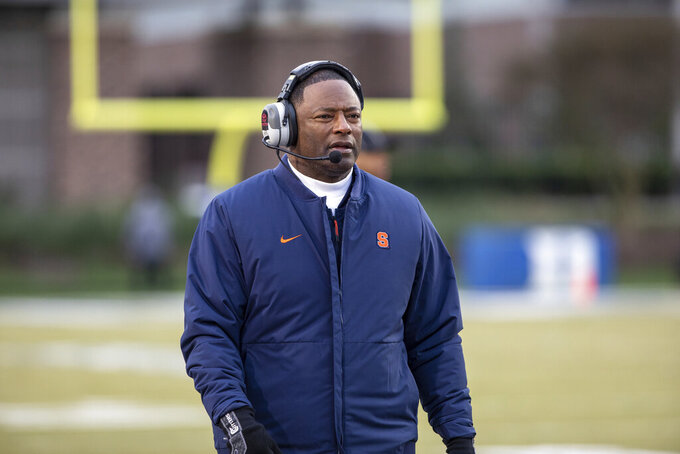 """FILE - Syracuse head coach Dino Babers walks the sideline during an NCAA college football game against Duke in Durham, N.C., Saturday, Nov. 16, 2019. Babers enters his fifth year at the helm often repeating a phrase he despises: """"I don't know."""" Such is life during a pandemic, when an invisible foe can alter a lineup in the blink of an eye. Less than two weeks before the season opener, Babers is trying to mold his team while also assuaging any fears the players voice regarding both the novel coronavirus and the racial tension across America. (AP Photo/Ben McKeown, File)"""