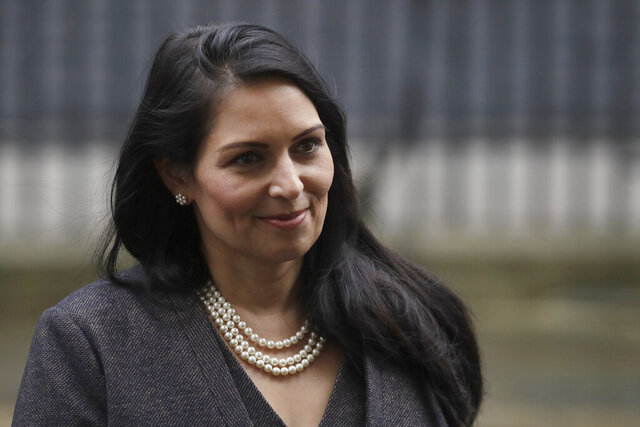 British Lawmaker Priti Patel, the Home Secretary leaves 10 Downing Street in London, Thursday, Feb. 13, 2020. British Prime Minister Boris Johnson shook up his government on Thursday, firing and appointing ministers to key Cabinet posts. Johnson was aiming to tighten his grip on government after winning a big parliamentary majority in December's election. That victory allowed Johnson to take Britain out of the European Union in January. (AP Photo/Matt Dunham)