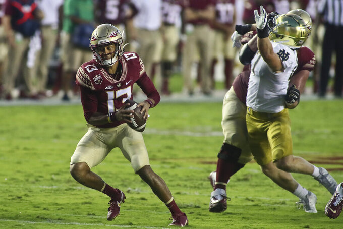 Florida State quarterback Jordan Travis (13) scrambles in the first quarter of an NCAA college football game Sunday, Sept. 5, 2021, in Tallahassee, Fla. (AP Photo/Phil Sears)