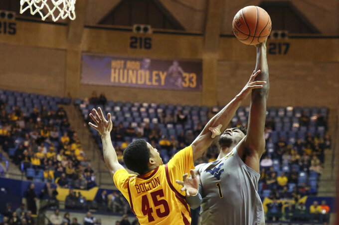 West Virginia forward Derek Culver (1) shoots as he is defended by Iowa State guard Rasir Bolton (45) during the second half of an NCAA college basketball game Wednesday, Feb. 5, 2020, in Morgantown, W.Va. (AP Photo/Kathleen Batten)