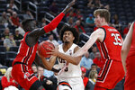 Oregon State's Ethan Thompson drives between Utah's Both Gach, left, and Branden Carlson during the first half of an NCAA college basketball game in the first round of the Pac-12 men's tournament Wednesday, March 11, 2020, in Las Vegas. (AP Photo/John Locher)