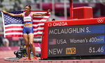 Sydney McLaughlin, of United States celebrates after winning the gold medal in the final of the the women's 400-meter hurdles at the 2020 Summer Olympics, Wednesday, Aug. 4, 2021, in Tokyo, Japan. (AP Photo/Martin Meissner)