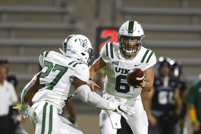 Portland State quarterback Davis Alexander (6) hands the ball off to Portland State running back Malik Walker (27) during the first half of an NCAA college football game against Hawaii, Saturday, Sept. 4, 2021, in Honolulu. (AP Photo/Darryl Oumi)