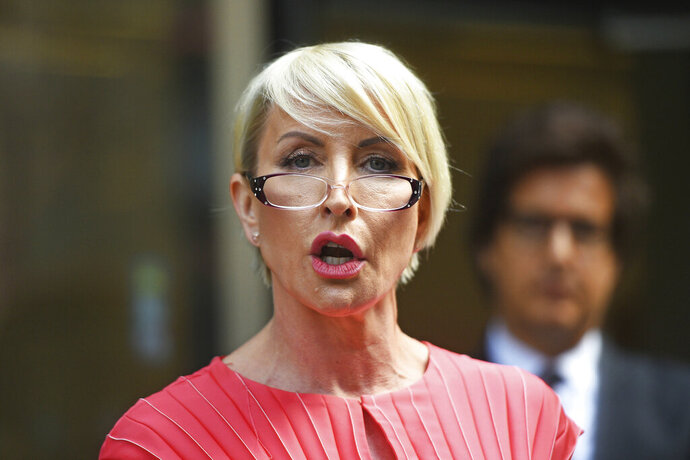 Heather Mills speaks outside Rolls Building at the end of her legal phone-hacking claim against News Group Newspapers, in London, Monday July 8, 2019.  Businesswoman and campaigner, Heather Mills, settled her claim Monday over phone-hacking against News Group Newspapers (NGN), for a public apology and an undisclosed sum. (Kirsty O'Connor/PA via AP)