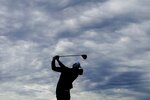 Team USA's Tony Finau hits a shot on the sixth hyole during a practice day at the Ryder Cup at the Whistling Straits Golf Course Thursday, Sept. 23, 2021, in Sheboygan, Wis. (AP Photo/Charlie Neibergall)