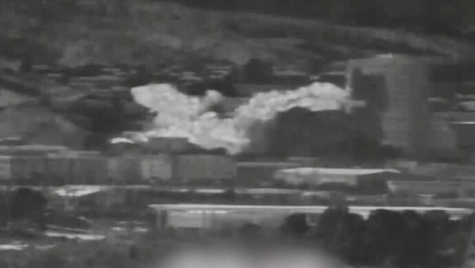 In this photo provided by South Korea Defense Ministry via Yonhap News Agency, an image from a thermal observation device showing the explosion of an inter-Korean liaison office building in North Korea's Kaesong is seen from Paju, South Korea, Tuesday, June 16, 2020. North Korea blew up an inter-Korean liaison office building just inside its border in an act Tuesday that sharply raises tensions on the Korean Peninsula amid deadlocked nuclear diplomacy with the United States.(South Korea Defense Ministry/Yonhap via AP)