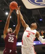Fordham's Joel Soriano, left, battles Dayton's Ibi Watson (2) for a rebound during the first half of an NCAA college basketball game Saturday, Feb. 1, 2020, in Dayton , Ohio. (AP Photo/Tony Tribble)