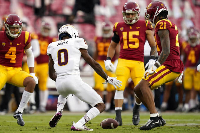 Arizona State defensive back Jack Jones (0) fumbles the ball on a punt return against Southern California during the first half of an NCAA college football game Saturday, Nov. 7, 2020, in Los Angeles. (AP Photo/Ashley Landis)