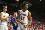 Arizona forward Zeke Nnaji (22) reacts after scoring against South Dakota State in the second half during an NCAA college basketball game, Thursday, Nov. 21, 2019, in Tucson, Ariz. (AP Photo/Rick Scuteri)