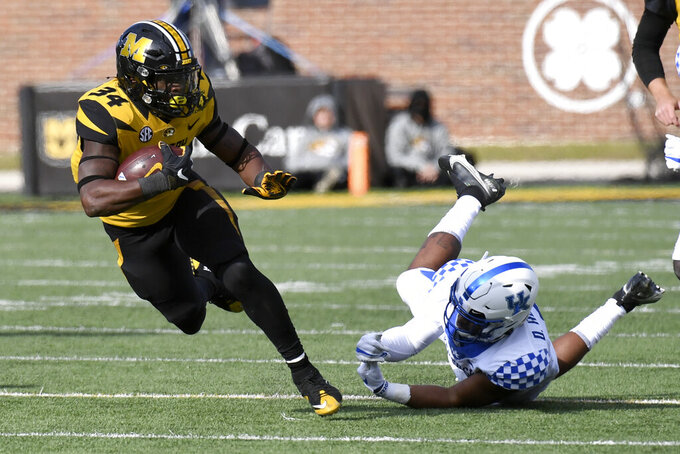 Missouri running back Larry Rountree III (34) runs with the ball as Kentucky defensive back Davonte Robinson, right, defends during the first half of an NCAA college football game Saturday, Oct. 24, 2020, in Columbia, Mo. (AP Photo/L.G. Patterson)