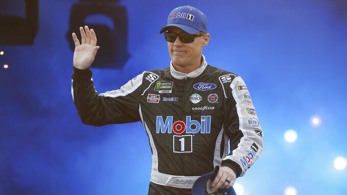 Kevin Harvick waves to fans during driver introductions prior to the start of the NASCAR Cup series auto race at Richmond Raceway in Richmond, Va., Saturday, April 13, 2019. (AP Photo/Steve Helber)