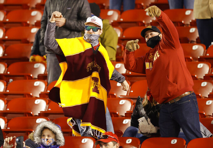 Fans cheer during the second half of an NCAA college football game between Iowa State and West Virginia, Saturday, Dec. 5, 2020, in Ames, Iowa. Iowa State won 42-6. (AP Photo/Matthew Putney)