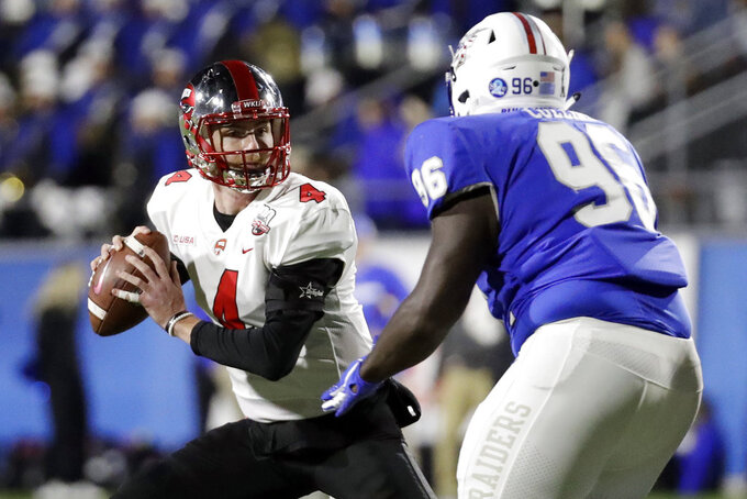 Western Kentucky quarterback Drew Eckels (4) is pressured by Middle Tennessee defensive lineman Rosheem Collins (96) in the first half of an NCAA college football game Friday, Nov. 2, 2018, in Murfreesboro, Tenn. (AP Photo/Mark Humphrey)