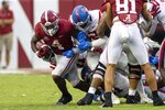 Alabama running back Brian Robinson Jr. (4) breaks through the Mississippi line with Mississippi defensive lineman Tariqious Tisdale (22) holding on to him during the second half of an NCAA college football game, Saturday, Oct. 2, 2021, in Tuscaloosa, Ala. (AP Photo/Vasha Hunt)