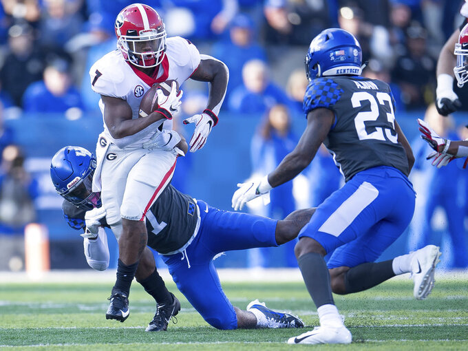 Georgia running back D'Andre Swift (7) runs with the ball during the first half an NCAA college football game against Kentucky in Lexington, Ky., Saturday, Nov. 3, 2018. (AP Photo/Bryan Woolston)