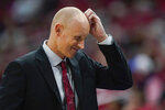 FILE - Louisville head coach Chris Mack reacts to a play during the first half of an NCAA college basketball game against Virginia Tech in Louisville, Ky., in this Sunday, March 1, 2020, file photo. The NCAA has amended its Notice of Allegations against Louisville, adding additional violations committed by the men's basketball program that include impermissible activities and accusations coach Chris Mack did not promote an atmosphere for compliance. Already under review by the Independent Resolution Panel (IRP) for violations related to a college basketball corruption case detailed in a May 2020 NOA, the school received the amendment on Thursday, Sept. 30, 2021, from the governing body's Complex Case Unit. (AP Photo/Bryan Woolston, File)