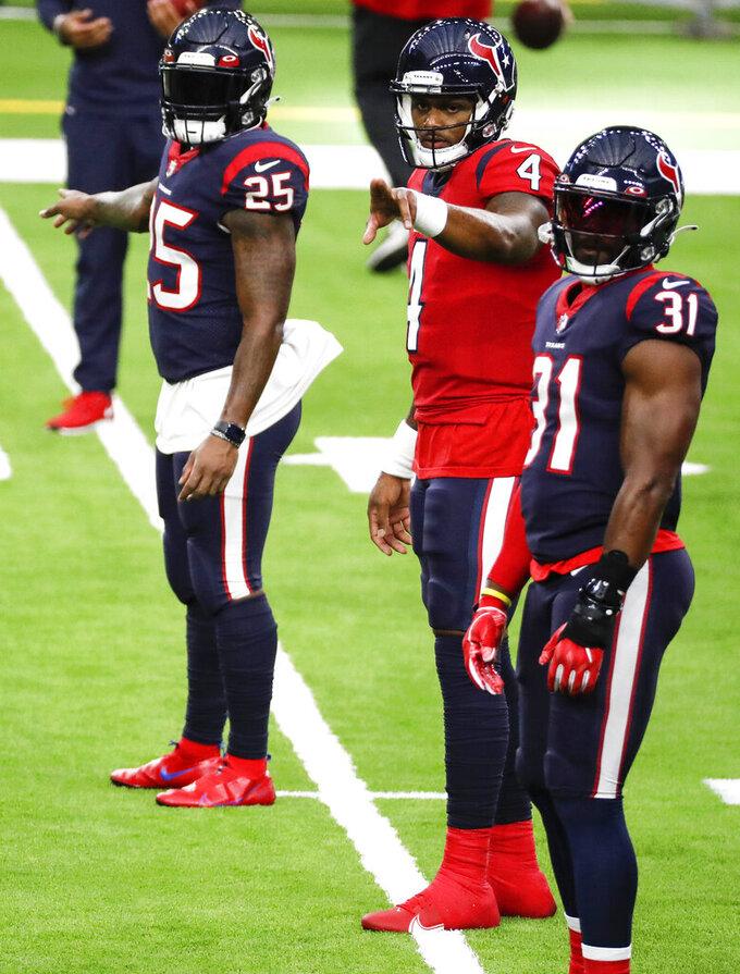 Houston Texans quarterback Deshaun Watson (4) calls out signals as he lines up with running backs Duke Johnson (25) and David Johnson (31) during NFL football training camp Thursday, Aug. 27, 2020, in Houston. (Brett Coomer/Houston Chronicle via AP, Pool)