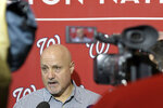 Washington Nationals general manager Mike Rizzo talks with members of the media during the team's