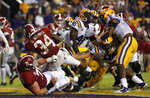 Alabama running back Damien Harris (34) crosses the goal line for a touchdown in the second half of an NCAA college football game against LSU in Baton Rouge, La., Saturday, Nov. 3, 2018. Alabama won 29-0. (AP Photo/Gerald Herbert)